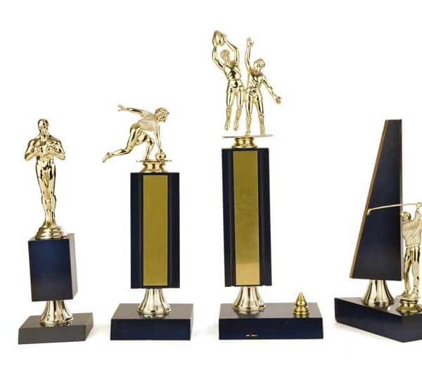 Gold Plastic Sporting Figure on Wooden Base